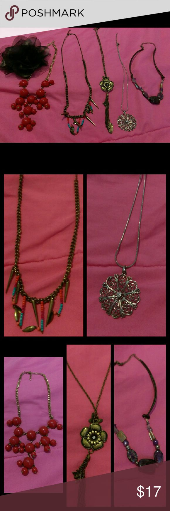 Jewelry Bundle This is a great bundle! Great addition to your closet! Price is negotiable  Contents: Black flower hair pin - great condition Red bubble necklace - good condition  Bronze flower with tassel necklace - great condition Silver flower necklace - excellent condition  Purple stone necklace - perfect condition Jewelry Necklaces