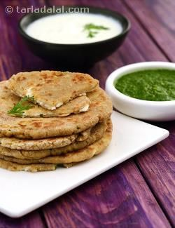 These paneer stuffed parathas are a meal in their own right. Remember not to give too much force when patting the parathas to ensure that they do not break.