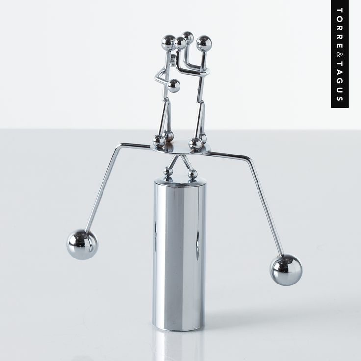 Another great Father's Day gift idea! These kinetic motion metal balancing figurines are perfect as a playful gift for any occasion - especially Father's Day. A must have desk accessory that provides Dad with hours of endless entertainment! www.torretagus.com #TorreAndTagus #fathersdaygifts #FathersDay #giftideas