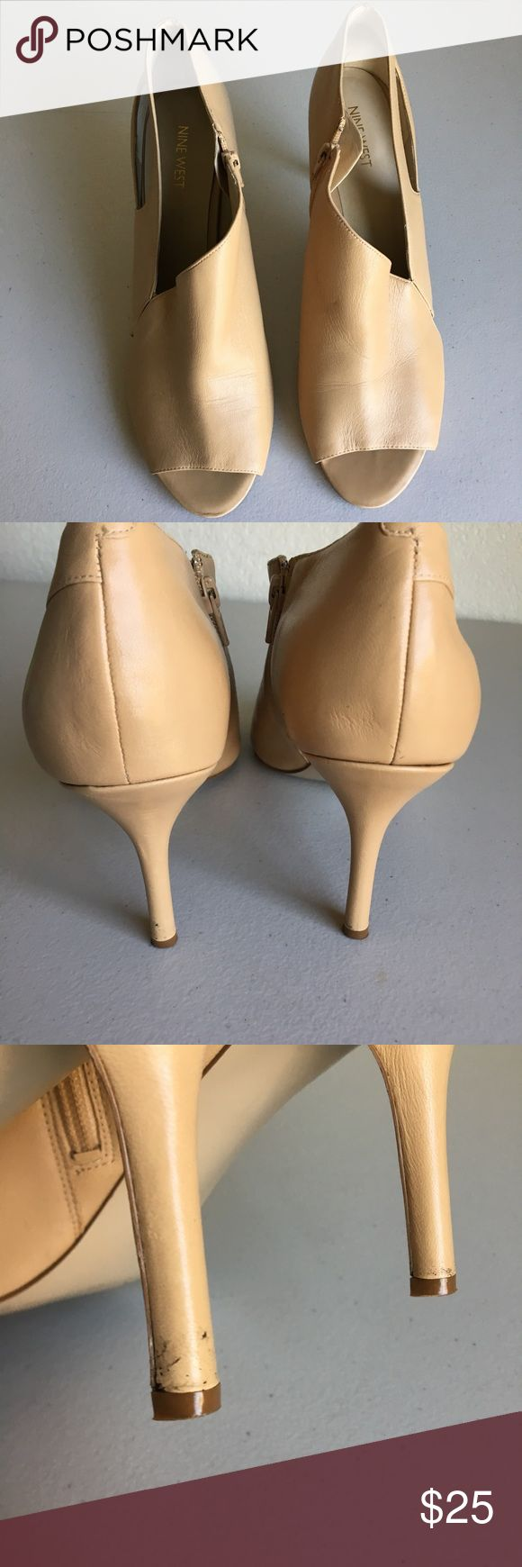 Nine West Pumps, size 12 Super cute, Nine West Pumps, size 12 color tan, feature a zipper on the side and a slit on the other side of each shoe, the are still in excellent shape except for the heels, but is barely noticeable. Nine West Shoes Heels