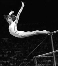 Nadia dismounting bars in 1976 Olympics.  I first saw her compete BEFORE the Olympics in Denver.  She was amazing.