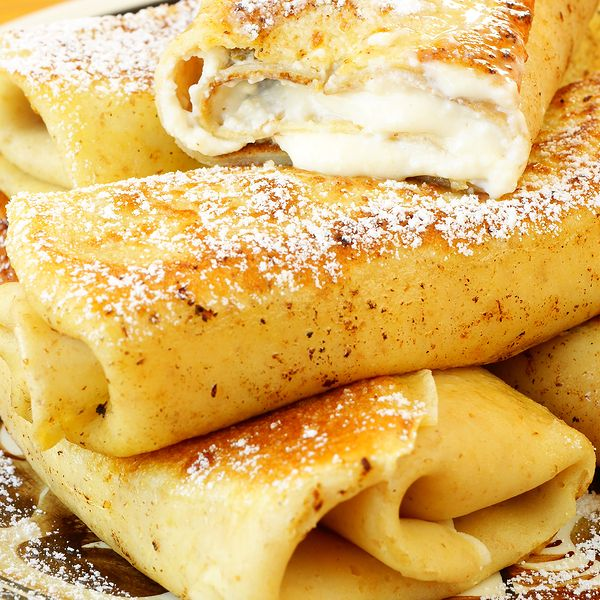 A sweet cheese blintz recipe that is easy to make and is a delicious breakfast.. Sweet Cheese Blintzes Recipe from Grandmothers Kitchen.