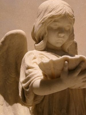 This is a Statue of an angel in Bonaventure Cemetery in Savannah Georgia by maria.t.rogers