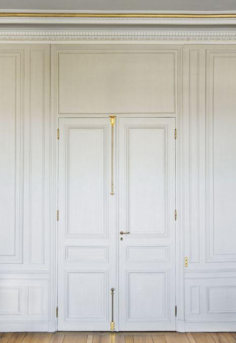 Door & Paneling Detail. Love the door hardware