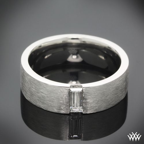 Cast in platinum, this Custom Men's Wedding Ring is 6mm wide and features a single 0.25ct baguette diamond in the center and is topped off with a lovely spin satin finish. If you would like to receive a custom quote for this design please call one of our friendly diamond consultants at 1-877-612-6770.