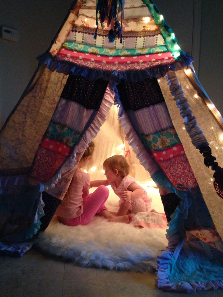 Bohemian Teepee with Faux Fur Rug from Etsy - love this eclectic play space!