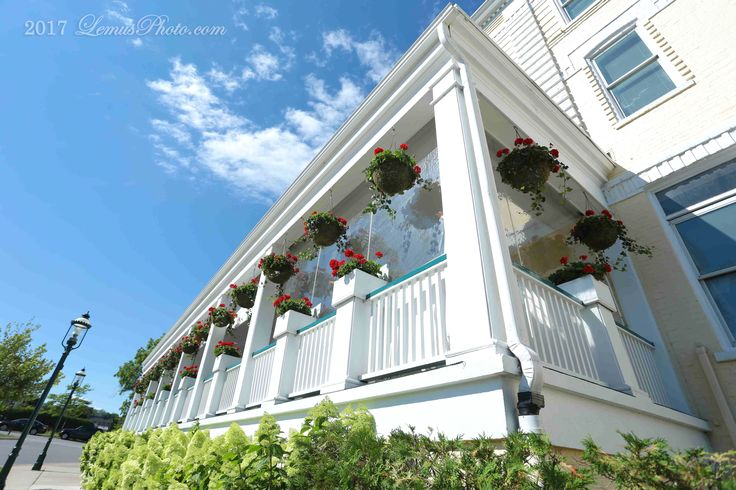 Photos by LemusPhoto.com. Stafford's Perry Hotel in Petoskey, Michigan is a charming location for weddings. The registered Michigan Historic Site hotel has been a favorite in the resort town since it was built in 1899 for Norman J. Perry as a northern Michigan summer getaway. The Classic Revival hotel at 100 Lewis, with Doric entrance, overlooks the sparkling Little Traverse Bay. The interior is well appointed and retains its 19th century glory with antique furnishings and decor seamlessly…