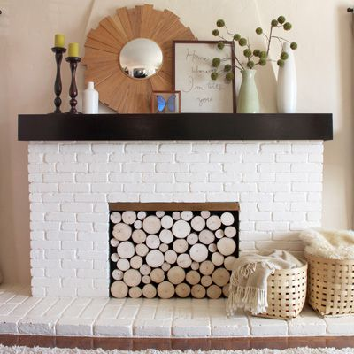 This blogger took a Pinterest challenge to create the look of stacked logs in her fireplace. #decor #fireplaces