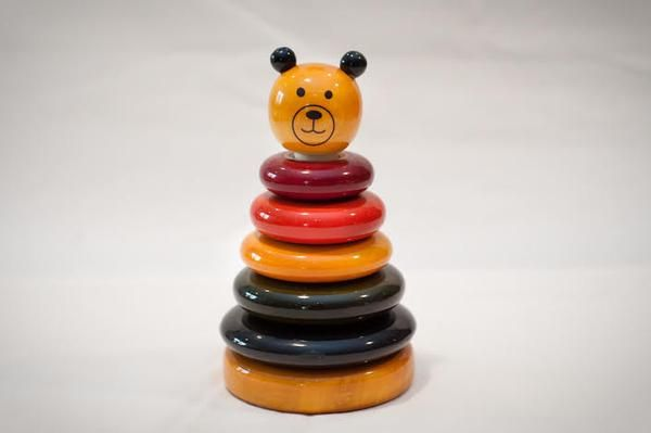 Cubby the bear is a beautiful wooden stacking toy made with traditional Indian techniques using natural dyes and has a lac finish. The coloured rings help child