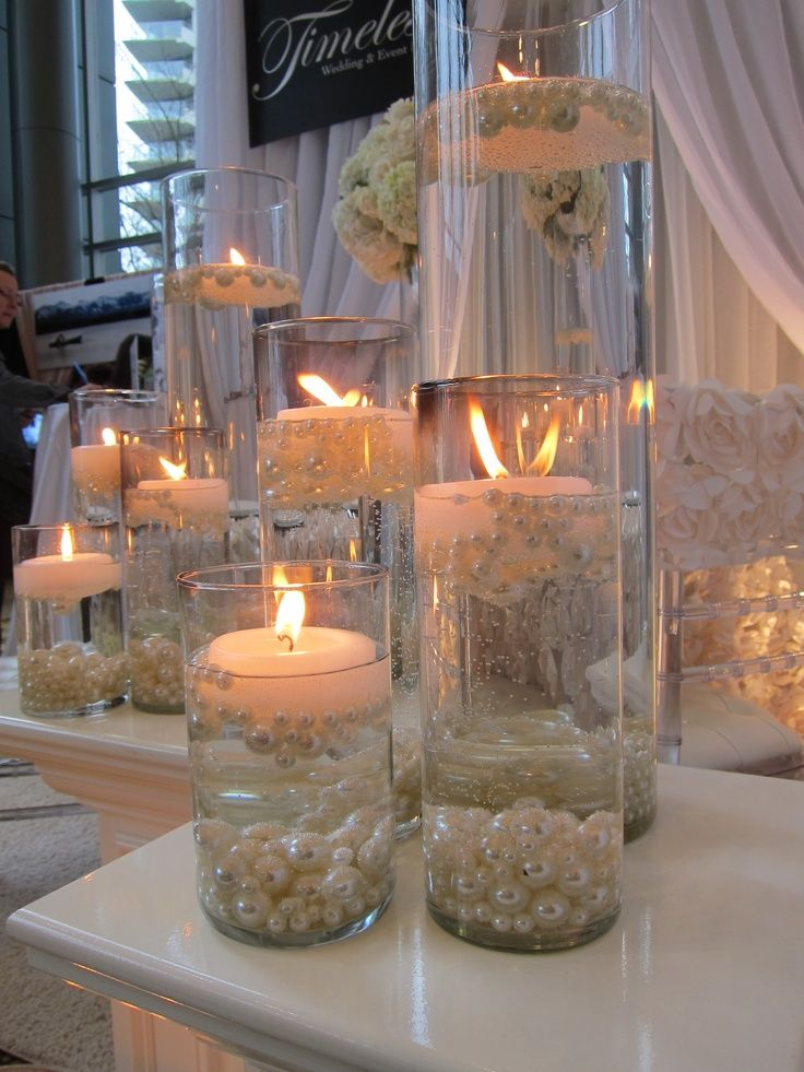 candle, sand and pearls event table decor | candles with pearls