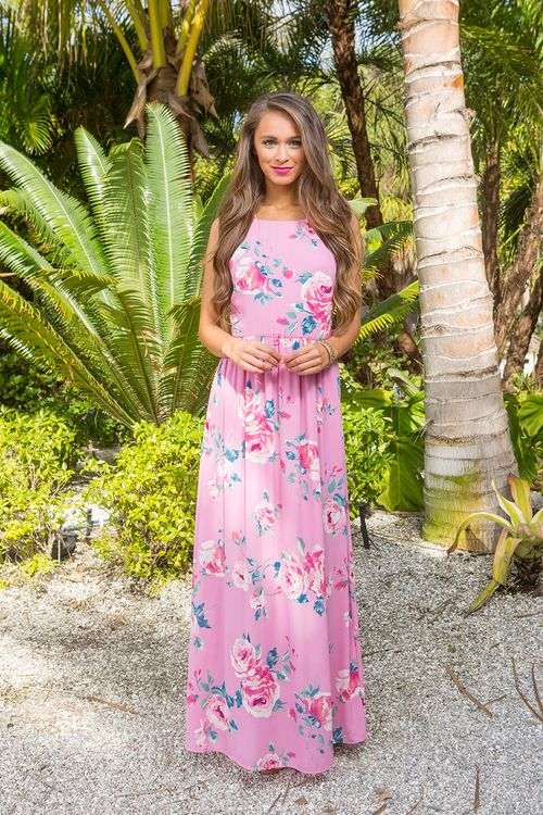 This romantic floral maxi is simply perfect for date night or a garden party! Featuring a lovely floral print in pink, white, peach, fuchsia, dark green, and light green, it's such a timeless and clas