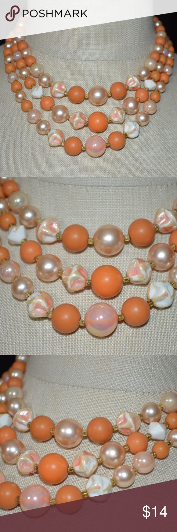 Vintage Japan Orange Peach Necklace Estate Fresh  Vintage JAPAN Orange Peach Multi Strand Beaded Crystal Gold Tone Choker Necklace  Appears clasp has been repaired 15.5 inch in length Japan Jewelry Necklaces