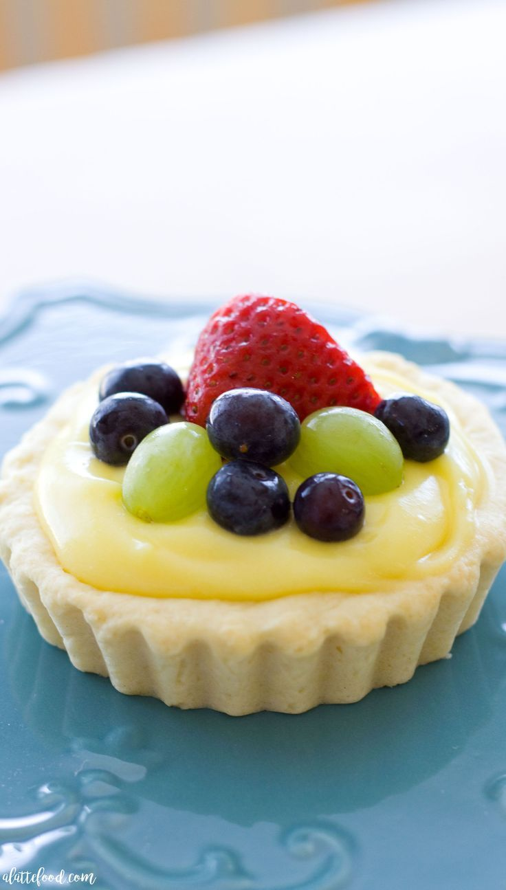These easy sugar cookie fruit tarts have a sugar cookie base and are filled with a sweet lemon pudding or custard filling. The tastiest lemon dessert!