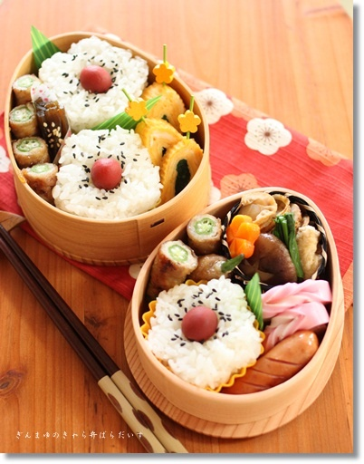 Traditional Japanese Ume Flower Shaped Rice with Umeboshi Bento Lunch © ぎんまゆさん