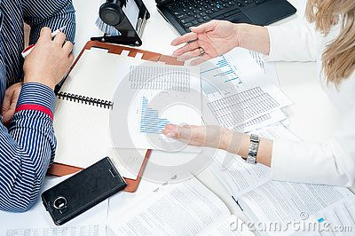 Damian Gretka. Microstock Photography.  Two people working in the office