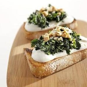 Nettle & Whipped Ricotta Crostini from San Francisco Gate - Whip ricotta with olive oil, for a luscious bite, then top with sauted nettles and crushed, toasted hazelnuts! Found at www.edamam.com.