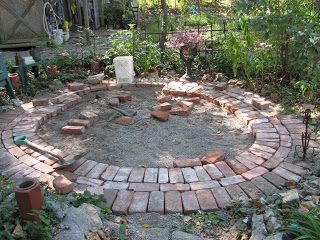 Circular brick patio area. I like how she altered the circles of brick in a perpendicular pattern too.