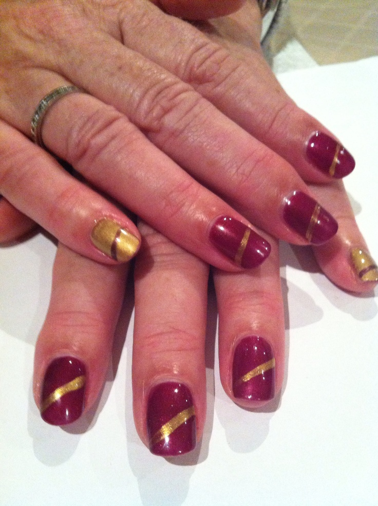 Nails - Masquerade 515, gold mica pigment powder, with stripe accents.