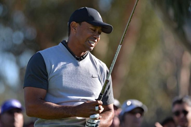 Golf: Inconsistent Woods six behind first-round leaders at Riviera