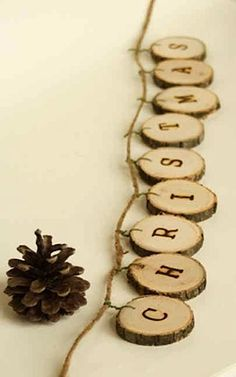 natural christmas decorations made from tree branch ring strung as garland