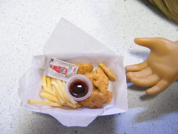 Don't get much for the money, but it is getting to be late in the day.  American Girl Food Chicken Dinosaur Nuggets by annsAGminiatures, $7.99