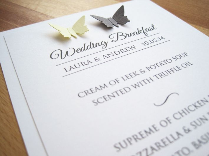 Butterfly Carnival Menu in white with grey and yellow 3D butterflies.