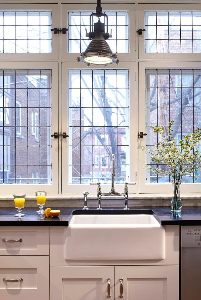 white casement grid window kitchen industrial with black counters fireclay apron-
