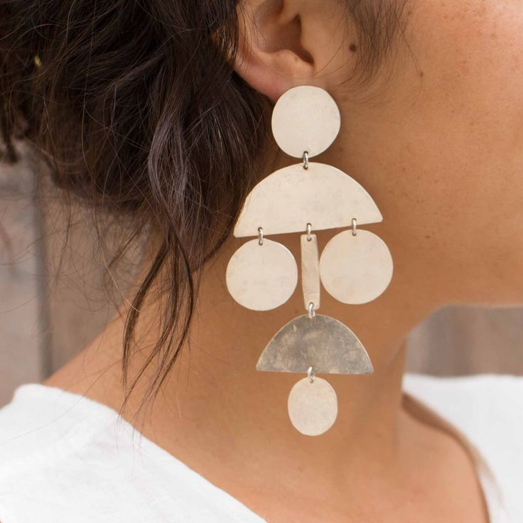 """Pom Pom Chandelier Earrings, silver or blue oxide, $219 (sold out) - Handmade, lightweight, burnished silver or matte oxide blue earrings by Los Angeles based designer, Annie Costello Brown. Sterling silver ear posts and backs. Each piece is individually hand cut and slightly unique.  Oxide blue color may change over time with wear.  Approximately 4.5"""" tall and 2.5"""" wide."""