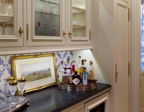 Butlers Pantry With Antique Etched Glass Panel In Upper Cabinet Petite Granite Counter Top Painted Cabinets Wine Cooler