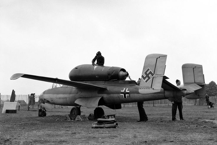 """Many of Germany's captured new and experimental aircraft were displayed in an exhibition as part of London's Thanksgiving week on September 14, 1945. Among the aircraft are a number of jet and rocket propelled planes. Here, a side view of the Heinkel He-162 """"Volksjaeger"""", propelled by a turbo-jet unit mounted above the fuselage, in Hyde park, in London."""