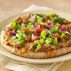 Pita breads make a perfect crust for individual pizzas topped with refried beans and melted cheese, sprinkled with crisp lettuce and zesty tomatoes