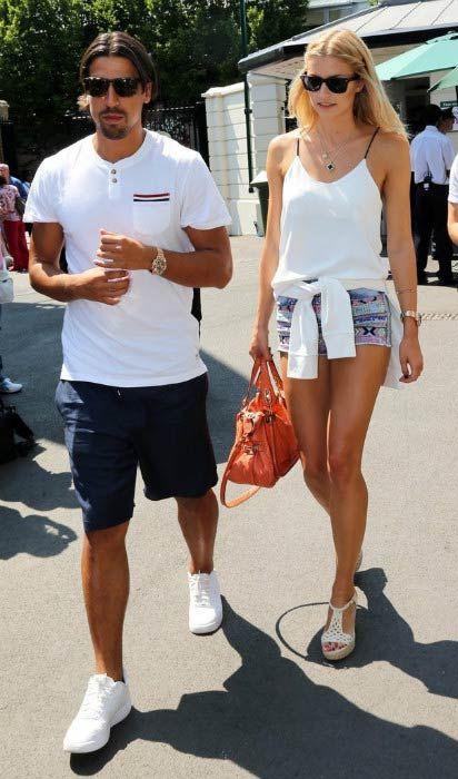 Sami Khedira and Lena Gercke at the Men's Final during Wimbledon Tennis Championships in London in July 2013...
