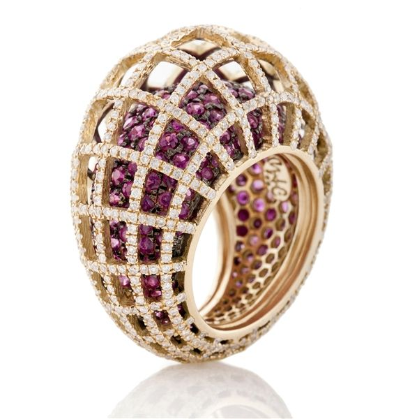Looking for ideas for your holiday wish list? Look no further. Nada G's Matrix Double Color Ruby and Diamond Cocktail Ring is a stunning masterpiece of design and color. Check out the 18k yellow gold geometric ring that features 2.70 ct. t.w. white diamonds and 6.10 ct. t.w. rubies.   It's like a double ring of eye candy! Doubly delish! ;-) www.diamonds.pro