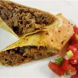 Tender seasoned shredded pork fill these cheesy burritos that are lightly fried to a golden brown. You can also serve them as soft burritos.