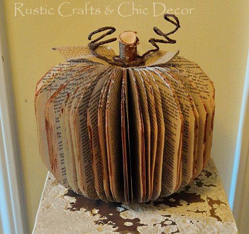 Transform An Old Paperback Book Into A Decorative Pumpkin -  a few of these would look great on the mantle this fall.  I think I'll try paperbacks and books of different sizes.  I have a statistics book I wold love to see transformed into something useful!