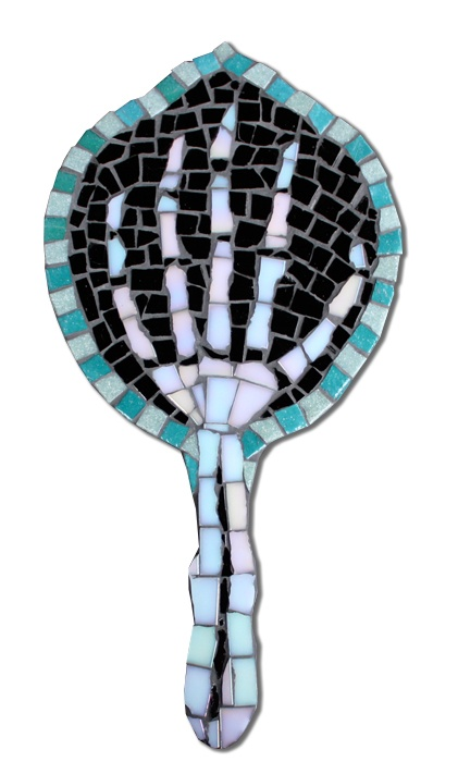 £55 'Juan is Dead' mirror.  Each vitreous glass tile is hand cut to create this entertaining mosaic on the reverse of a venetian-style hand mirror.  Jet Black, Pearl White and 2 Shades of Turquoise Vitreous Glass Tiles.  Trading Wednesdays and Fridays.  www.juanisdead.com