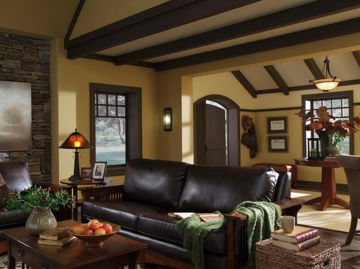 Traditional Beamed Ceilings A Stacked Stone Wall Warm Colors And Substantial Furnishings Give This Living Room Adjacent Entryway Welcoming Yet