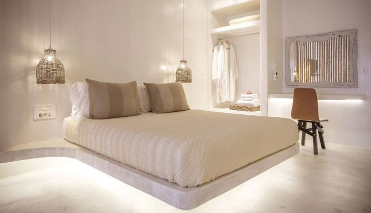 Cool white contemporary interiors in Greek desginer bedroom at the luxury Villas of the Naxian Collection