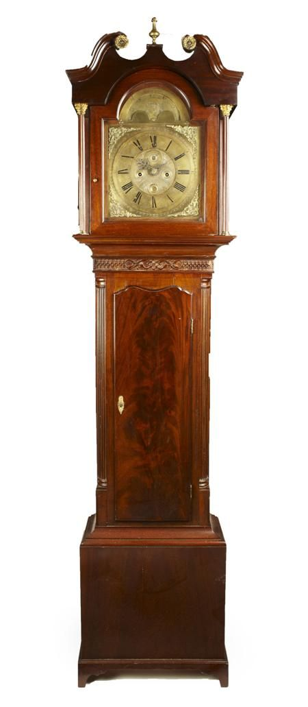 IRISH GEORGE III MAHOGANY LONGCASE CLOCK - LATE 18TH CENTURY - the brass moonphase dial inscribed J. Honny, Dublin, with subsidiary second dial and date aperture, with an 8-day bell striking movement, the hood with a broken swan neck pediment above a blind fret carved frieze and shaped figured mahogany door, flanked by fluted quarter columns and raised on shaped bracket feet 55cm wide, 228cm high, 25cm deep
