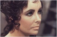 """MARCH 23, 2011 - """"Elizabeth Taylor, the actress who dazzled generations of moviegoers with her stunning beauty and whose name was synonymous with Hollywood glamour, died on Wednesday in Los Angeles. She was 79."""" Read more: http://www.nytimes.com/2011/03/24/movies/elizabeth-taylor-obituary.html?pagewanted=all"""