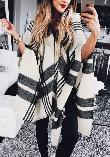 This black and white plaid blanket shawl features frayed edges detailing all over its fabric. It looks perfect when paired with vintage tee, boyfriend jeans, and matte leather booties. Buy here. | Lookbook Store
