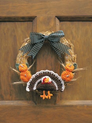 Free Pattern - This fun #crochet wreath with a turkey at the center will get your guests in the spirit for #Thanksgiving.