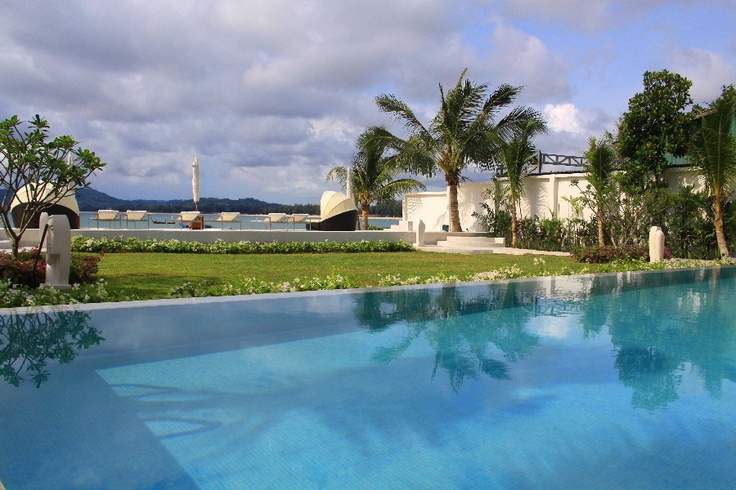Swimming pool and beach views at the Beachfront Luxury Condo in Phuket, Thailand