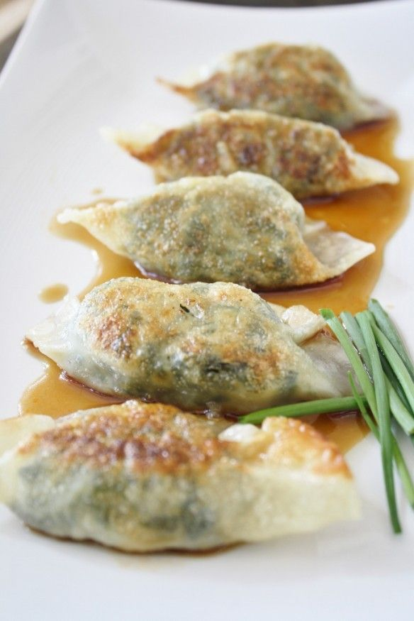 Vegetarian Dumplings. Made with frozen spinach, scallion, small onion, garlic, cilantro, silken tofu, salt, pepper, won ton skins, soy sauce, rice wine vinegar, sesame oil, and chives.