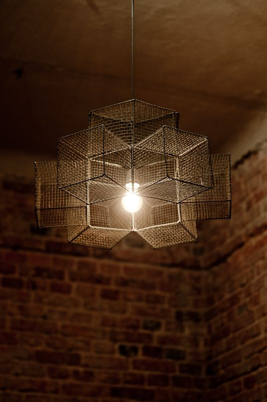 Snowflake cage chandelier pendant light. This is S/M style chandelier - raw, symmetric and as plain as possible. It gives web-like shadows on celiling.  It's made with 9 test-tube baskets bought from Polish Army. #wzory_targi