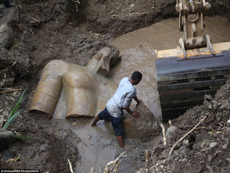 Archaeologists from Egypt and Germany have found a massive 26ft (8 metre) statue submerged in ground water in a Cairo slum. Researchers say it probably depicts revered Pharaoh Ramses II, who ruled Egypt more than 3,000 years ago