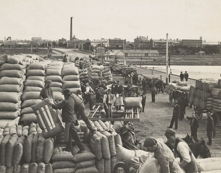 Waterside workers handling bags and bales, Yarra Street Pier, Geelong | by State Library Victoria Collections