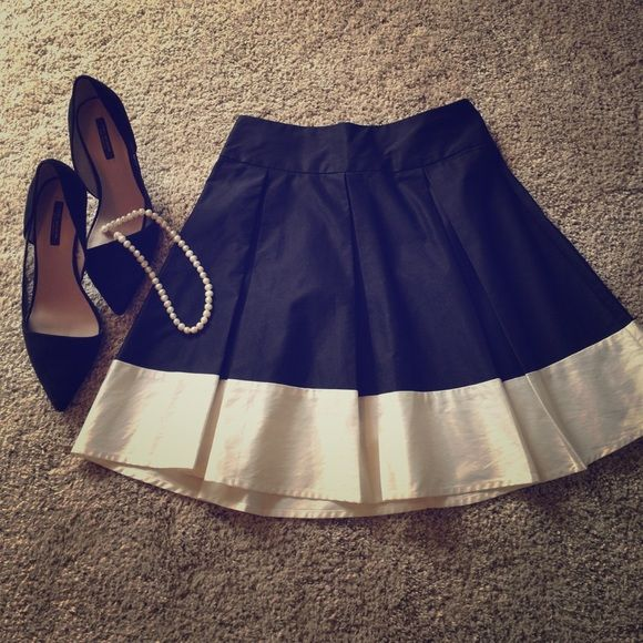 Black and white pleated skirt. Adorable black and white, pleated skirt from H&M. Zips up in back. Worn once for engagement shot. H&M Skirts