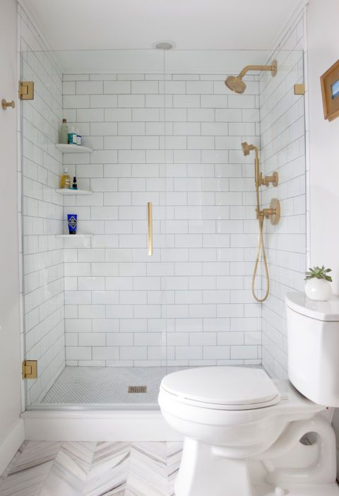 Chrome shower accessories, like the door handle, knobs, and even drain (!) add decorative elements to the bathroom, which allows the room design as a whole to feel clean and open (but not overwhelming). See more at Elements of Style »