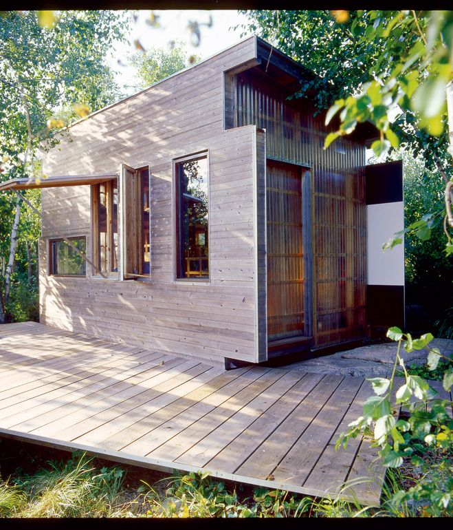 The exterior is clad in an elegant mish-mash of cedar, plywood, glass, and fiberglass panels.  Photo by Thomas Fricke.